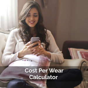 woman looking at calculator working out how much her clotes cost using the cost per wear calculator