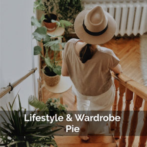 lifestyle and wardrobe calculator, woman looking over balcony with a hat on